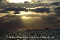 Ship in Sunrays