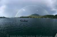 Skiff Under Double Rainbow